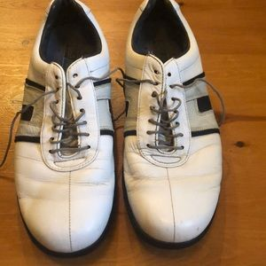 White Footjoy golf shoes